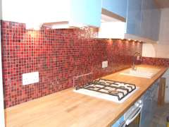 red glass mosaics in kitchen